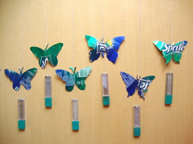 Diy recycled soda can butterfly wind chime m de by lakshmi for Images of wall hanging with waste material